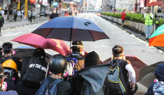 Hong Kong protesters braced to face the police.