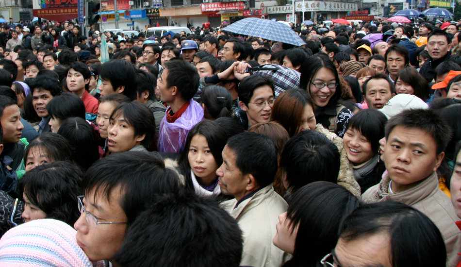 A crowd of people waiting outside the train station in Guangzhou, China.