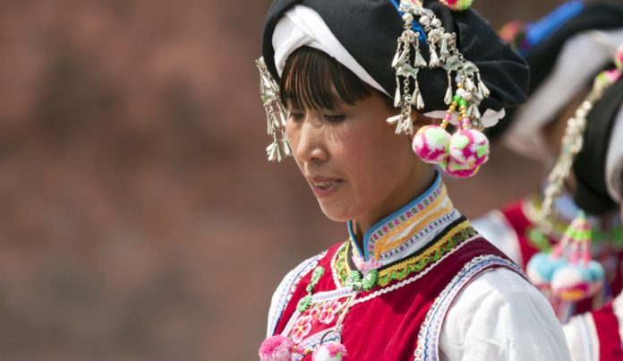 Yi minority woman in traditional clothes.